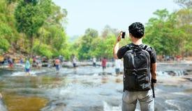Traveller man bagpack for travel Stock Images