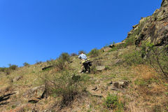 Traveller. The man with bicycle rises uphill stock photos