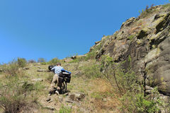 Traveller. The man with bicycle rises uphill stock photo