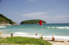 Traveller old man travel and sit on the Nai Harn beaches Stock Images