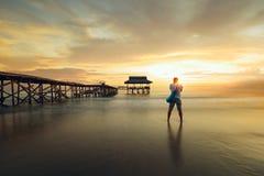 Traveller photographed golden sunset near the pier Stock Photos