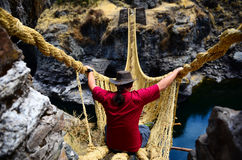 Traveller on a rope bridge stock photo
