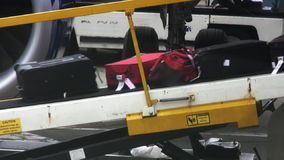 Traveller's Baggage Exiting Airplane. Baggage on conveyor belt at airport stock video footage