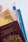Traveller's check: money, passport, ticket. A British passport, some euro notes and air ticket: just the job for a visit to the Continent stock image