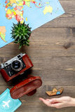 Traveller set with camera and map on wooden background top view mock-up. Traveller set with photo camera, passport and map in vacation design on wooden table Stock Image