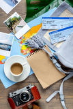 Traveller set with coffee and tickets on wooden background top view Royalty Free Stock Photos