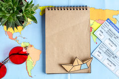 Traveller set with glasses and tickets map background top view mock up Royalty Free Stock Image