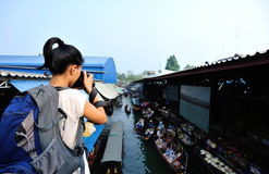 Traveller shooting at Damonen Saduak floating market Royalty Free Stock Photo