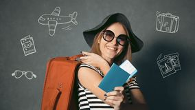 Traveller Shows Passport and Ticket. Smiling traveller with suitcase at the back showing passport and ticket, isolated shot with travel animation icons stock footage