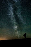 Traveller silhouette on milky way Royalty Free Stock Images