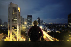 Traveller Sitting On The Top Of Building Stock Photography