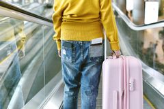 Traveller standing with a luggage at airport terminal. stock photo