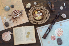 Traveller Still Life. Still life with shells and maps Royalty Free Stock Image