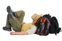 Traveller in straw hat lies on backpack and sleeps Royalty Free Stock Images