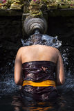 Traveller take a bath at Holy Spring Water Tirta Empul Hindu Temple , Bali Indonesia. Stock Photos