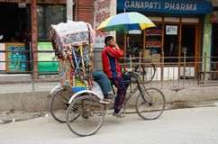 Traveller take a local bicycle rickshaw in Kathmandu,Nepal Stock Image