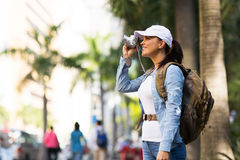 Traveller taking photos. Pretty female traveller taking photos in the city Stock Photos
