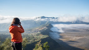 Traveller taking a picture of Cemoro Lawang. Cemoro Lawang is locate in Tengger Semeru National Park, East Java, Indonesia royalty free stock images