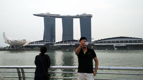 Traveller Taking Selfie with Marina Bay Sands and cityscape Stock Photos