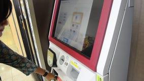 Traveller thai woman buying ramen from vending machine. SAITAMA, JAPAN - OCTOBER 19 : Traveller thai woman buying ramen from vending machine at Noodle ramen shop stock footage