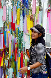 Traveller thai woman join and writing her wishes small pieces of. Paper and hanging them on bamboo in Tanabata or Star festival Japanese festival on July 7 Stock Images