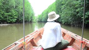 Traveller thai woman sit on long tail boat for looking and travel view riverbank stock footage