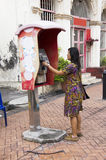 Traveller thai woman using public telephone or payphone booth ca Royalty Free Stock Images