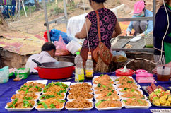 Traveller travel and buy food from Laotian people at local night Stock Photo