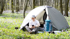 Traveller uses a smartphone outdoors. Backpacker uses a smartphone outdoors stock video footage