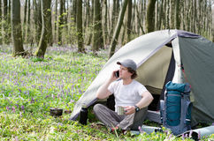 Traveller uses a smartphone outdoors. Royalty Free Stock Images