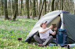 Traveller uses a tablet outdoors. Royalty Free Stock Images
