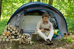 Traveller Uses A Tablet Outdoors. Stock Images