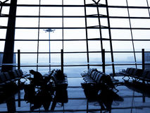 Traveller waiting for plane Royalty Free Stock Photo
