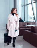 Traveller walking the airport hall. Royalty Free Stock Photo