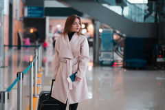 Traveller walking the airport hall. Royalty Free Stock Photos
