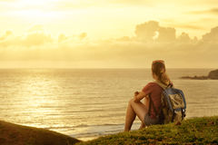 Free Traveller With Backpack Enjoying Sunset Listening To Music On Pe Royalty Free Stock Photography - 84795377