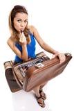 Traveller woman applying makeup Stock Image