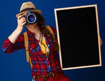 Traveller woman with blackboard taking photo with digital camera Stock Photos