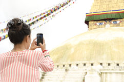 Traveller woman capturing photo of Boudhanath Royalty Free Stock Image