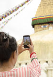Traveller woman capturing photo of Boudhanath Stock Photo