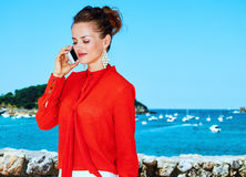 Traveller woman in Donostia, Spain talking on a mobile phone Royalty Free Stock Photography