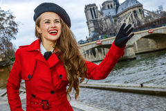 Traveller woman on embankment in Paris, France handwaving Stock Photos