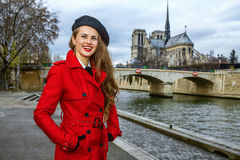 Traveller woman on embankment in Paris looking into the distance Stock Images