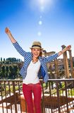 Traveller woman in front of Roman Forum rejoicing Stock Photo