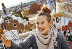 Traveller woman at Guell Park taking selfie with mobile phone Royalty Free Stock Image