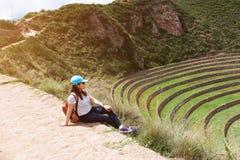 Traveller woman in Inca ruins Stock Photo
