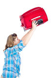 Traveller woman lifting luggage Royalty Free Stock Image
