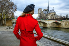 Traveller woman looking at Notre Dame de Paris in Paris, France Royalty Free Stock Photography