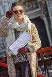 Traveller woman in Milan, Italy with map looking into distance Stock Image