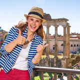 Traveller woman near Roman Forum in Rome showing thumbs up Royalty Free Stock Photo